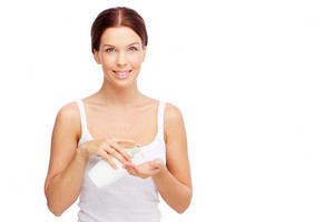 Portrait Of Healthy Young Woman With Liquid Soap Or Body Lotion Looking At Camera