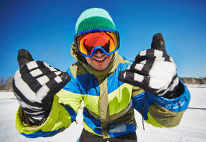 Young Snowboarder In Sportswear Looking Through Protective Eyeglasses At Winter Resort