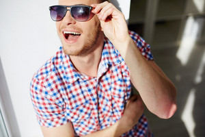 Young Guy In Sunglasses Posing For Camera