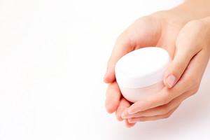 Image Of Beautiful Female Manicured Hands Holding Cream