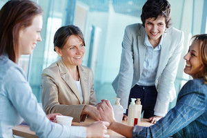 Image Of Four Businesswomen Having Friendly Talk