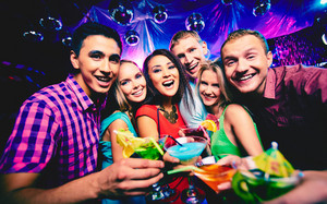 Group Of Happy Friends Toasting With Cocktails At Party