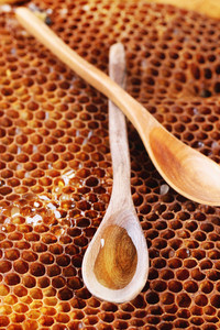 Wooden Spoon On Honeycombs