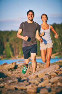 Photo Of Happy Young Couple Running Outdoors