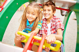 Image Of Happy Friends Having Fun On Playground Together
