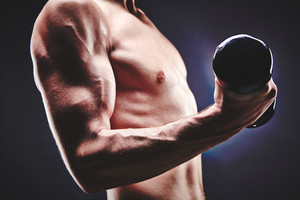 Close-up Of Sporty Man With Bare Torso Doing Exercise With Barbell