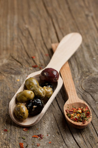 Tow Spoon With Olives And Spices
