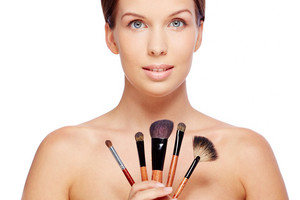 Portrait Of Young Female With Beauty Tools Looking At Camera