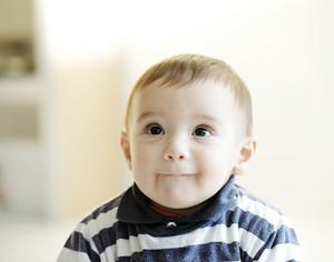 Beautiful smiling cute cheerful baby
