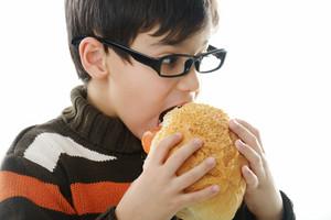Kid eating bread bun