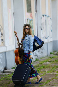 Beautiful musician woman traveling