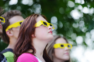 Group of friends in the park wearing 3d glasses