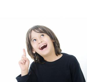 Educational theme: boy teenager showing upward