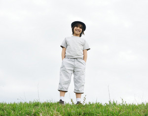 Child standing on a green meadow