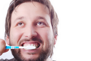 Man cleaning teeth with brush