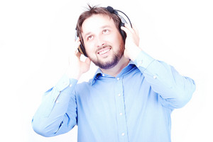 Young white beautiful man with headphones