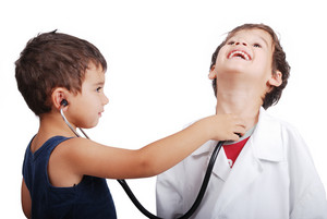 Doctor kid examining pulse to other kid
