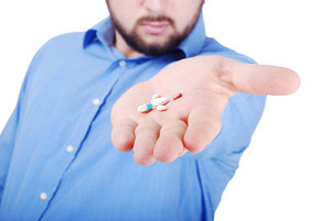 Isolated man offering medical pills