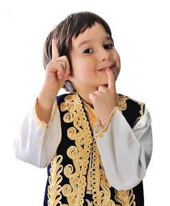Little boy in traditional middle-eastern clothes