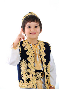 Cute little kid wearing traditional middle-east clothes finger pointing