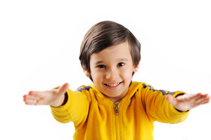 Smiling boy with the outstretched arms on a white background