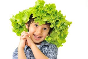 Kid enjoying salad on his head