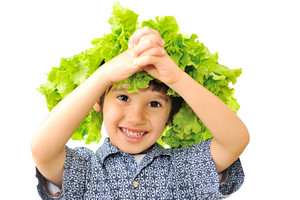 Cute little kid with salad on his head