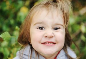Portrait of a cute funny  little girl outside