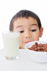Kid looking at flakes and glass of milk