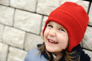 Adorable little girl with positive smiling face