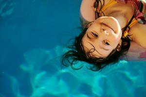 Little cute girl in pool