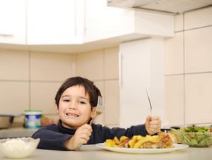 Litlle kid boy in  kitchen