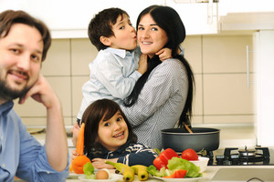 Mother And Children Prepare A meal