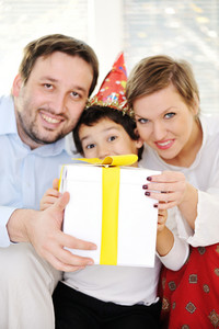 Happy family celebratin son's birthday