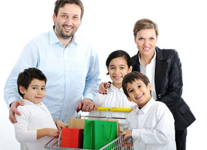 Happy family with a shopping cart