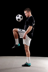 Soccer player doing tricks with ball