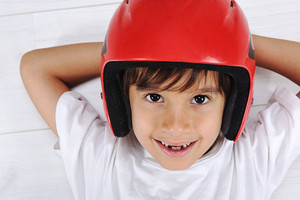 Little cute boy with helmet on head laying relaxed