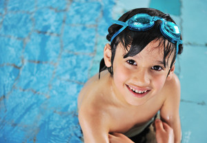 Cute little kid in swimming pool