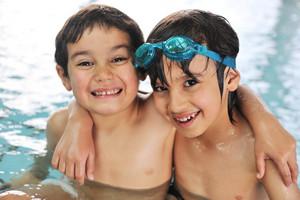 Cute little kid in swimming pool