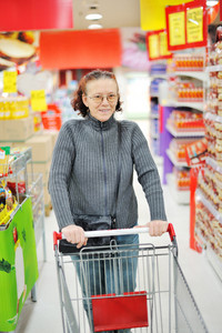 Elderly woman in supermarket