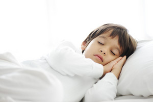 Kid on sleeping bed