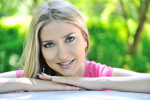 Beautiful blonde girl smiling outdoors
