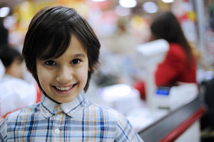 Smiling kid in shopping