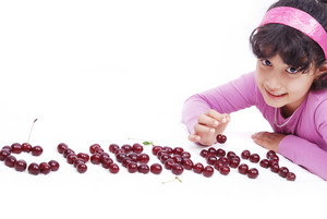 Kid with cherry