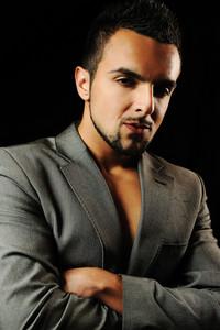 Young attractive macho stylish fashionable man