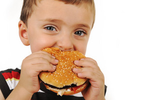 Boy eating burger