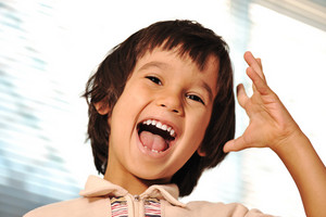 Happy child indoor with hand gesture