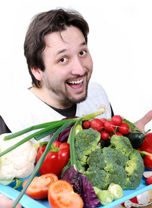 Man with many different vegetables