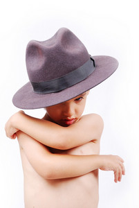 Little kid with hat on head and emotional expression