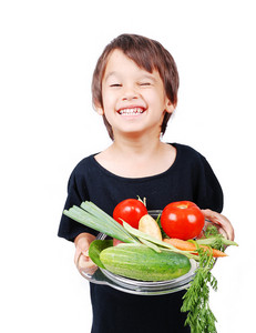 Boy with vegetables in hands